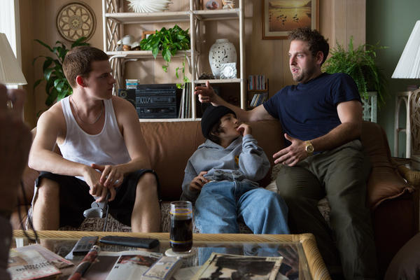 Jonah Hill (right) talks through a scene with Lucas Hedges (left) and Sunny Suljic. Many of the teenagers he cast were first-time actors.