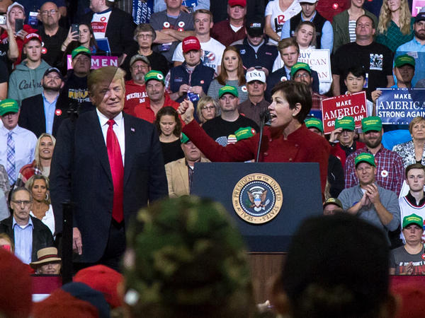 Iowa Gov. Kim Reynolds speaks to a crowd at a campaign rally with President Trump in Council Bluffs, Iowa, on Oct. 9.
