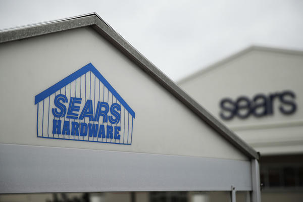 Signs for a Sears department store is displayed in Norristown, Pa., Monday, Oct. 15, 2018. Sears filed for Chapter 11 bankruptcy protection Monday, buckling under its massive debt load and staggering losses. (AP Photo/Matt Rourke)