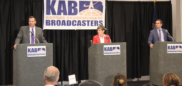 Republican Kris Kobach, left, Democrat Laura Kelly and independent Greg Orman debated in Wichita on Tuesday.