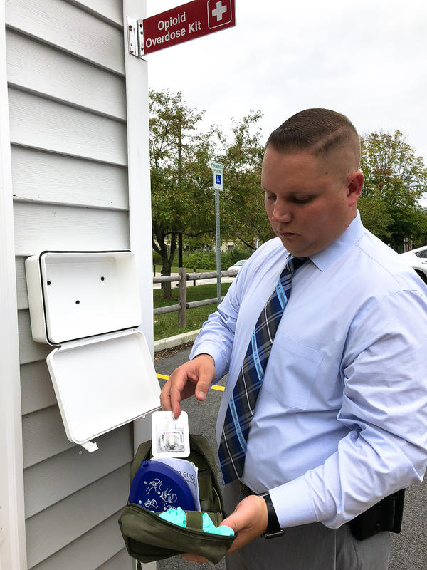 "Bridgewater State University campus police Detective Sergeant Robert McEvoy led the effort to place ""Opiod Overdose Kits,""  containing the overdose reversal drug Narcan, to more than 70 locations on campus, including outdoor parking lots like this one."