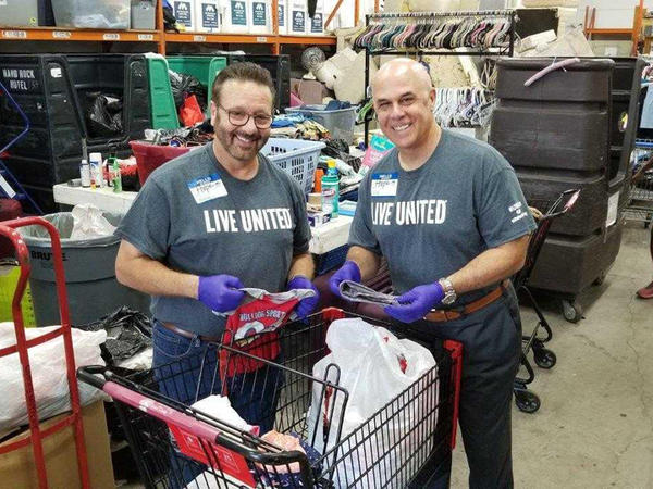 David Pizzo, left, Florida Blue Market President for West Florida, and Florida Blue CEO Pat Geraghty, right, volunteer at Metropolitan Ministries in Tampa.