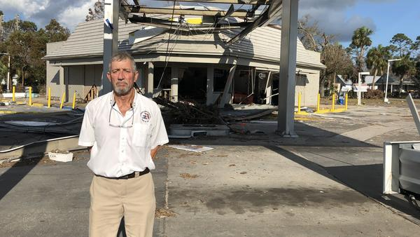 Port. St. Joe Mayor Bo Patterson stands in front of what's left of one of the towns two gas stations. Both were destroyed by Hurricane Michael, the fuel pumps torn from their concrete slabs.