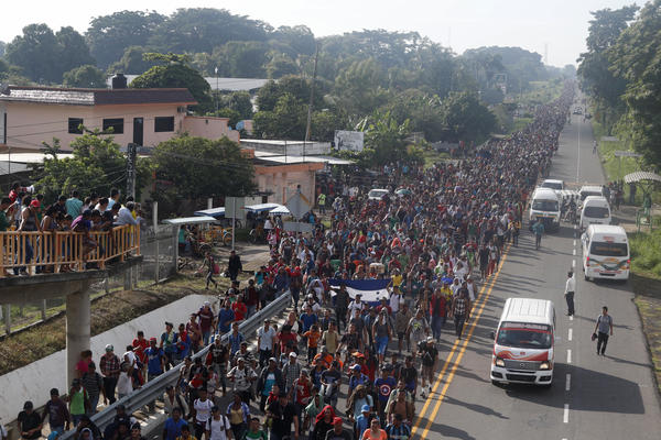Central American migrants walking to the U.S. start their day departing Ciudad Hidalgo, Mexico, on Sunday. Despite Mexican efforts to stop them at the border, thousands of Central American migrants resumed their advance toward the U.S. border early Sunday in southern Mexico.