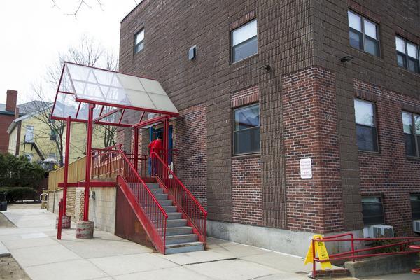 A resident walks into the Casa Esperanza's men's program in Roxbury. (Jesse Costa/WBUR)