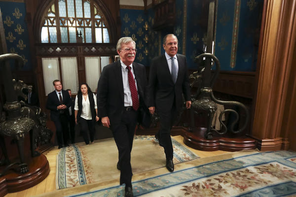 U.S. National Security Adviser John Bolton, left, and Russian Foreign Minister Sergey Lavrov enter a hall for their talks in Moscow, Russia, Monday, Oct. 22, 2018. U.S. President Donald Trump's national security adviser has met with top Russian officials after Trump declared he intended to pull out of a 1987 nuclear weapons treaty. (Russian Foreign Ministry Press Service via AP)