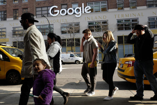 FILE - In this Dec. 4, 2017, file photo, people walk by the the Google office building on Ninth Avenue in New York. (AP Photo/Mark Lennihan, File)