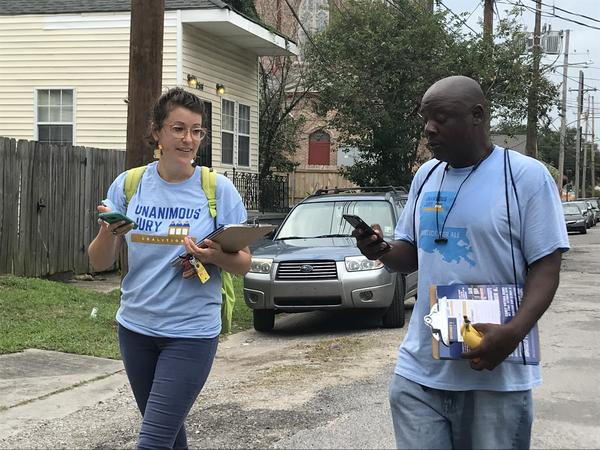 Unanimous Jury Coalition volunteers head out to knock on doors and talk to voters in Metairie.