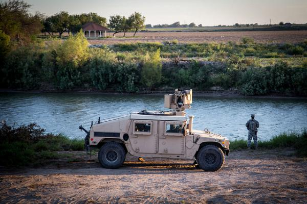 A soldier from the 36th Infantry Division of the Texas Army National Guard observes a section of the Rio Grande River in support of Operation Strong Safety.