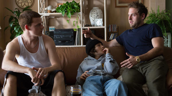 Director Jonah Hill (right) speaks with actors Lucas Hedges and Sunny Suljic on the set of <em>Mid90s</em>. Hill says the film was inspired in part by his own experiences as a teenage skateboarder.