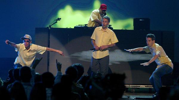 "Beastie Boys (L-R) Michael ""Mike D"" Diamond, Adam ""MCA"" Yauch and Adam ""Ad-Rock"" Horovitz perform at the 2004 MTV Movie Awards in Culver City, Calif."