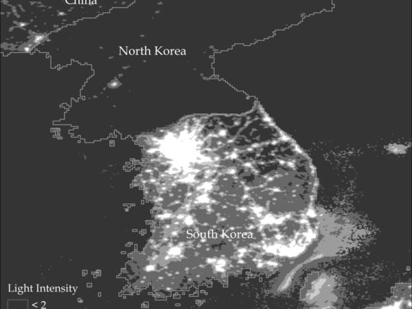 A satellite photo of North and South Korea at night.