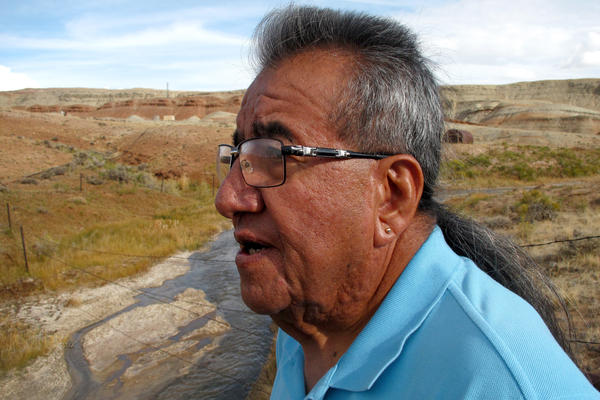 """Wes Martel, vice chairman for the Eastern Shoshone Business Council, stands near a murky gray stream full of oil field wastewater. He's concerned about the effects the wastewater has on wildlife, water quality and, since cows drink it, he wonders: """"What's in your steak?"""""""