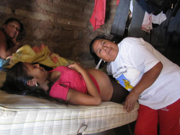 Macrina Martinez, the village midwife in Tlaquiltzingo, listens to an unborn baby's heartbeat.