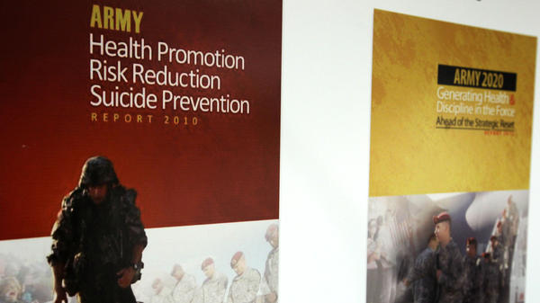"""U.S. military suicides rose in 2012. Here, the Army's """"Generating Health and Discipline in the Force"""" report, right, is seen last January. The reports was a follow-up to its """"Health Promotion/Risk Reduction/Suicide Prevention"""" report."""