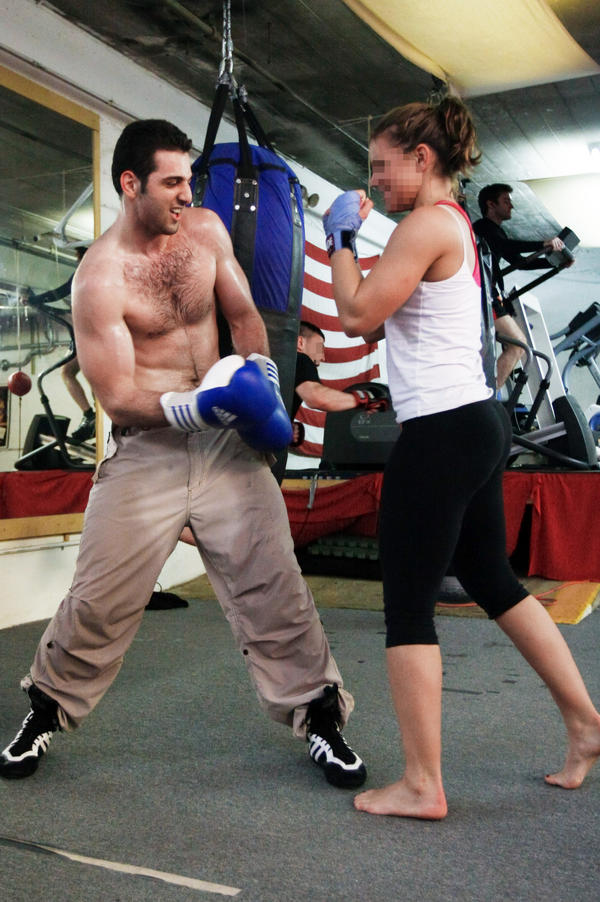 An unidentified woman boxes with the person believed to be Tamerlan Tsarnaev in April 2009 in Boston.