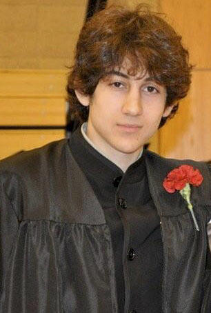 Dzhokhar Tsarnaev poses for a photo after graduating from Cambridge Rindge and Latin High School. Undated photo provided by Robin Young.