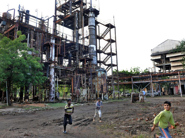 In this photograph from 2009, children play in front of the Union Carbide factory in Bhopal, India. Twenty-five years prior, in 1984, it was the site of a deadly gas leak that killed thousands of people.