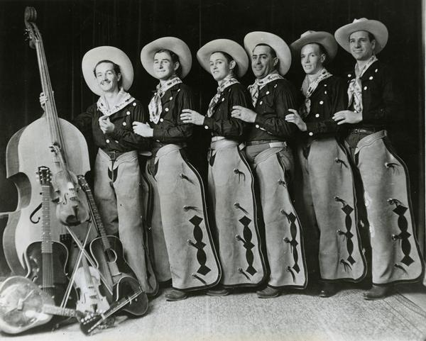 Woody Guthrie and the Pampa Junior Chamber of Commerce band, Pampa, Texas, 1936.