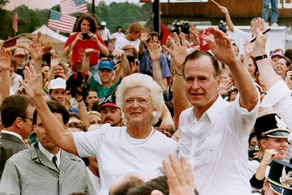 President and Mrs. Bush are surrounded by supporters during a campaign stop in Georgia on Aug. 22, 1992. Bush criticized Democratic presidential candidate Bill Clinton for seeking what he called the largest tax increase in U.S. history.