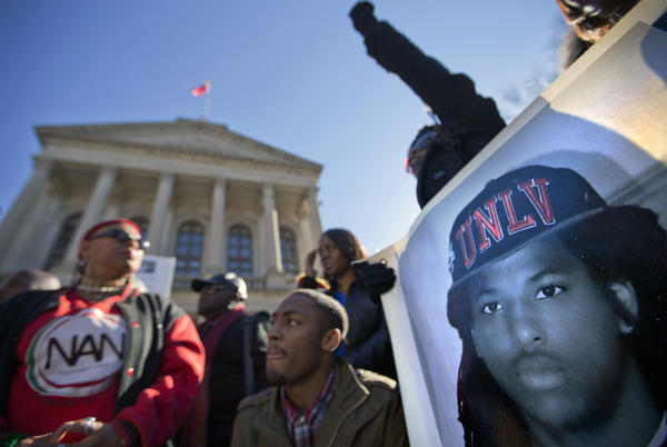 Demonstrators attend a rally on Wednesday in Atlanta for Kendrick Johnson, the Georgia teenager found dead inside a rolled-up wrestling mat in his school.