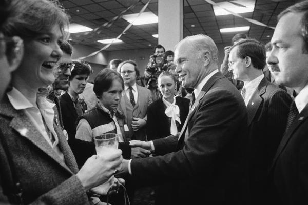 Glenn (center) shakes hands with unidentified supporters in Birmingham, Ala., on Super Tuesday, March 14, 1984. Glenn and Colorado Sen. Gary Hart were in a tight race for second place in the Alabama primary.
