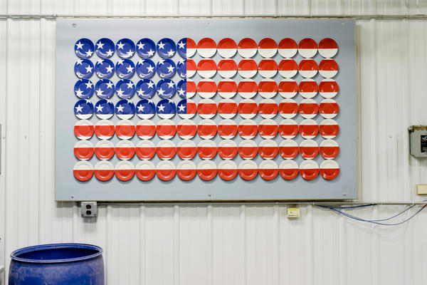 An American flag made of plates is displayed on a wall at Homer Laughlin China Co.