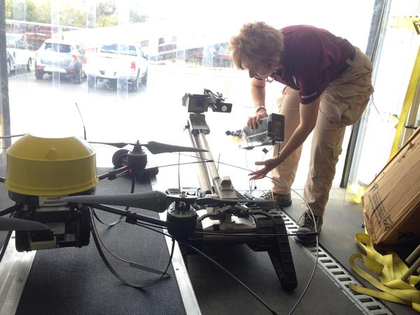 Robin Murphy, director of the Center for Robot-Assisted Search and Rescue at Texas A&M University, adjusts a robot used in hazardous waste cleanup.