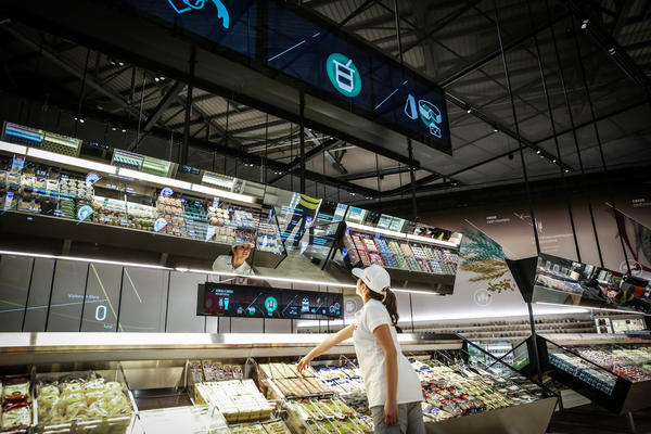 """Carlo Ratti of MIT designed this """"supermarket of the future"""" exhibit. If you move a hand close to a product, a digital display lights up, providing information on origin, nutritional value and carbon footprint."""