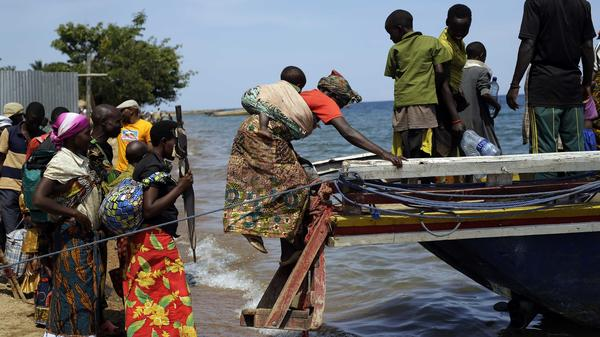 Refugees who fled Burundi's violence and political tension board a speedboat to reach a ship on Lake Tanganyika, Tanzania, on May 23. Some 100,000 refugees have fled Burundi for neighboring countries in recent months.