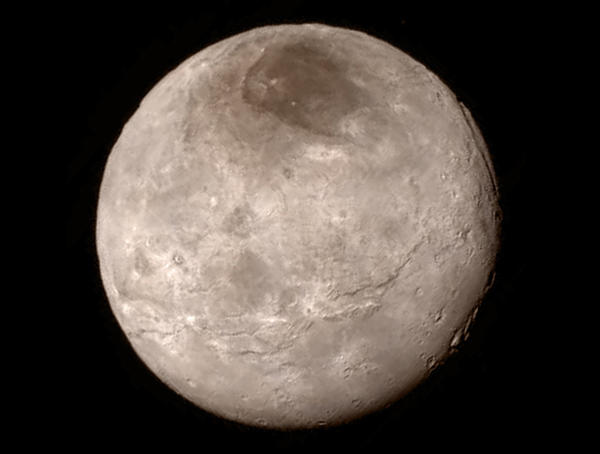 New details of Pluto's largest moon, Charon, are revealed in this image from New Horizons' Long Range Reconnaissance Imager.