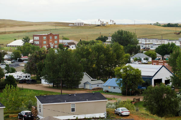 Oil wells sit atop a hill just outside Alexander, N.D., a small town of about 300 in the heart of the Bakken oil patch.