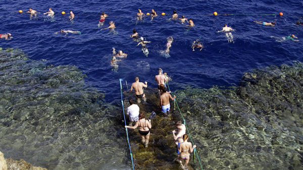 Russians flocked to Egypt's Red Sea resorts, like the one shown here in Sharm el-Sheikh on Nov. 7. But after a Russian plane was blown up, Russians have been barred from going. Russian tourists have also stopped going to Turkey, which recently shot down a Russian military plane.