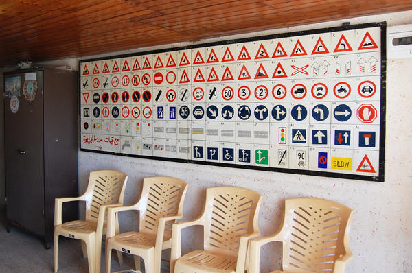 Road signs are displayed at a driving school in Gaza. Knowing the signs is only one challenge to driving in Gaza, where horse and donkey carts clop through traffic and few roads have lane lines.