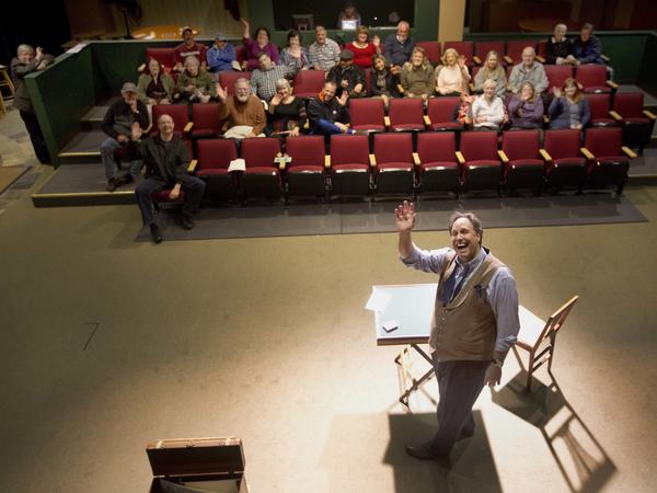 Magician Andrew Pinard waves during his performance at the Hatbox Theater in Concord, N.H. The theater took over the location of a closed clothing store at the Steeplegate Mall.