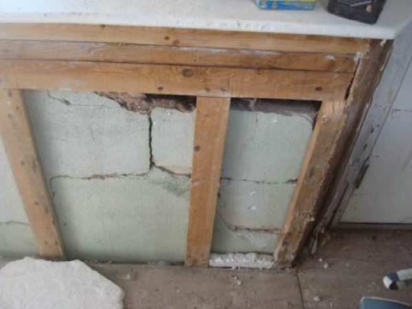 This photo, taken after Superstorm Sandy, shows cracks in the foundation of Doug Quinn's home. The insurance company claimed that the cracks were there before Sandy.