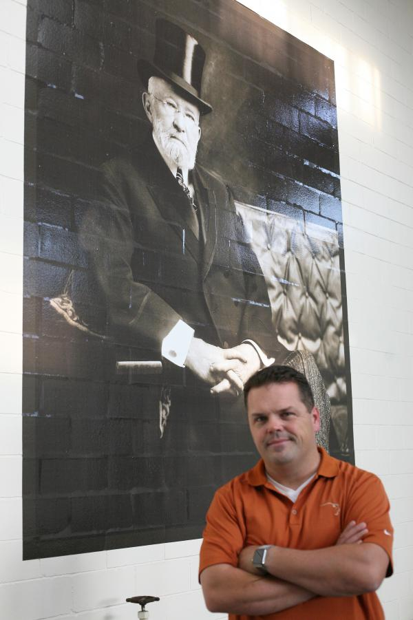 Master Distiller Harlen Wheatley stands below a portrait of E.H. Taylor, one of the founders of what is now the Buffalo Trace Distillery in Frankfort, Ky.