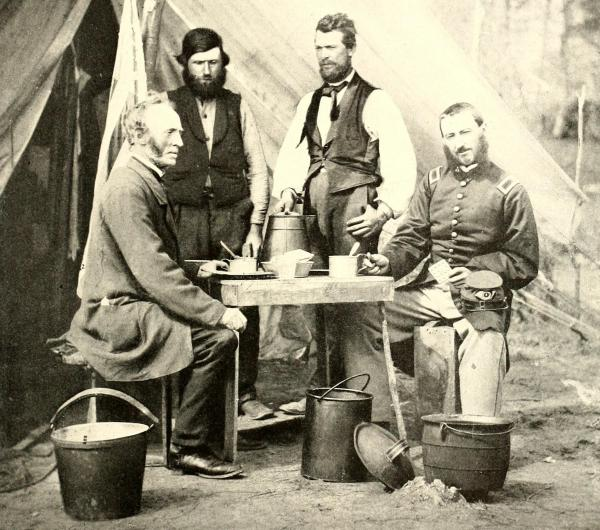 """""""Nobody can soldier without coffee,"""" a Union soldier wrote in 1865. (Above) Union soldiers sit with their coffee in tin cups, their hard-tack, and a kettle at their feet."""