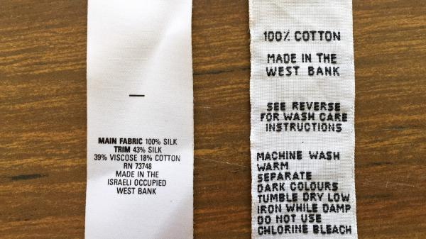 """When the lingerie factory was operating, the U.S. said that West Bank products could be marked """"Made in the Israeli Occupied West Bank"""" (left).  European labels from that time marked Palestinian products """"Made in the West Bank."""" The U.S. said that West Bank products could be marked """"Made in the Israeli Occupied West Bank"""" (left). Old European labels say """"Made in the West Bank."""""""