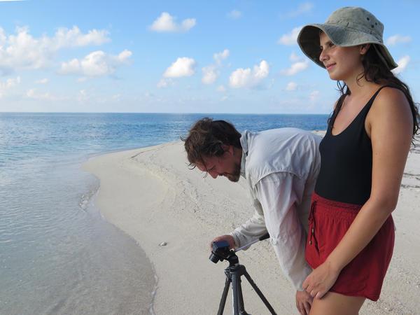 Carter McCormick and Paula Sprenger make images on the Loggerhead Key beach.