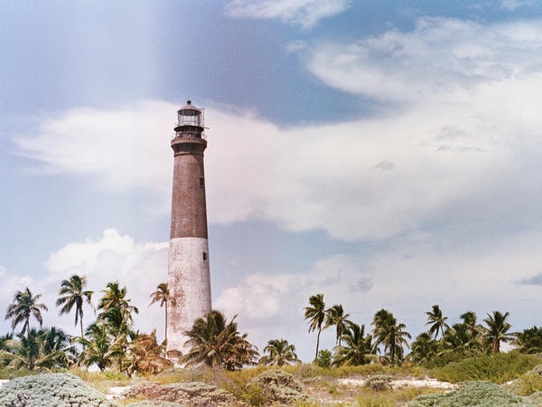 A lighthouse built in 1858 stands on Loggerhead Key, Fla., an uninhabited tropical island. Artists Paula Sprenger and Carter McCormick participated in a monthlong artist residency here.