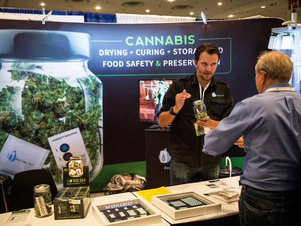 People attend the Cannabis World Congress Expo on June 19, 2015, in New York City. The fledgling legal market for marijuana is around $7 billion, industry researchers say.