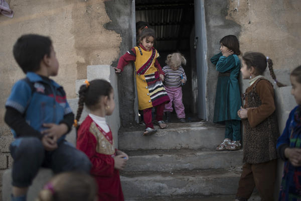 Iraqi children play at the Hassan Sham camp on Nov. 9.