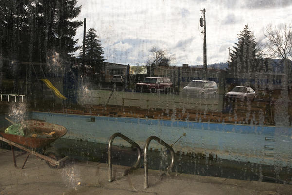 The community center at the Syringa Mobile Home Park has been closed and the pool once used by its residents has shut down and is now filled with scum.