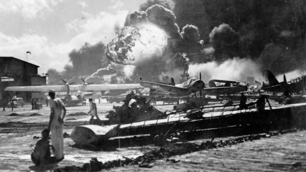 An explosion at the Naval Air Station Ford Island, Pearl Harbor, is seen during the Japanese attack. The U.S. is marking the 75th anniversary of the violence that thrust the country into World War II.