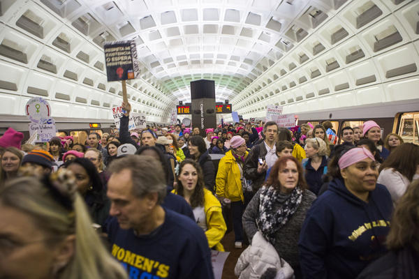 Protesters arrive at the Capitol South Metro station for the Women's March on Washington in Washington, D.C.