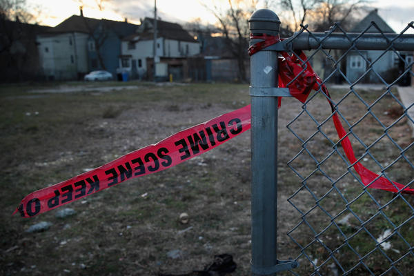 """Crime scene tape hangs in front of a vacant lot where a shooting occurred in December. President Trump tweeted last night about Chicago gun violence, saying he'll """"send in the Feds"""" if the city doesn't fix the carnage."""