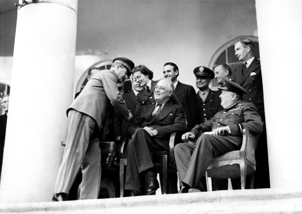Disabled by polio, Franklin Delano Roosevelt, the 32nd president, controlled his public image to deflect attention from his paraplegia. Roosevelt is seen with British Prime Minister Winston Churchill and Soviet leader Joseph Stalin at the Teheran Conference on Dec. 7, 1943.