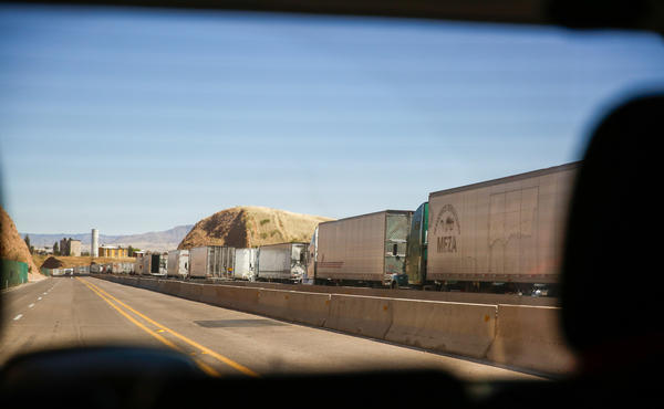 Dozens of 18-wheelers line up to cross the Nogales border, heading into the U.S.