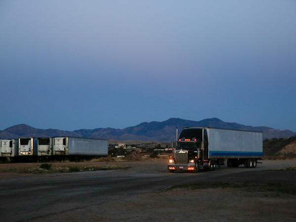Trucks carrying produce head back across the U.S. border from Nogales.